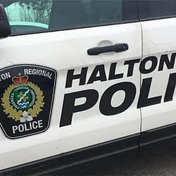 Two people charged after allegedly entering vehicles in Oakville