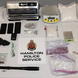 Hamilton Police seize more than $300K in drugs, weapons, cash from two homes